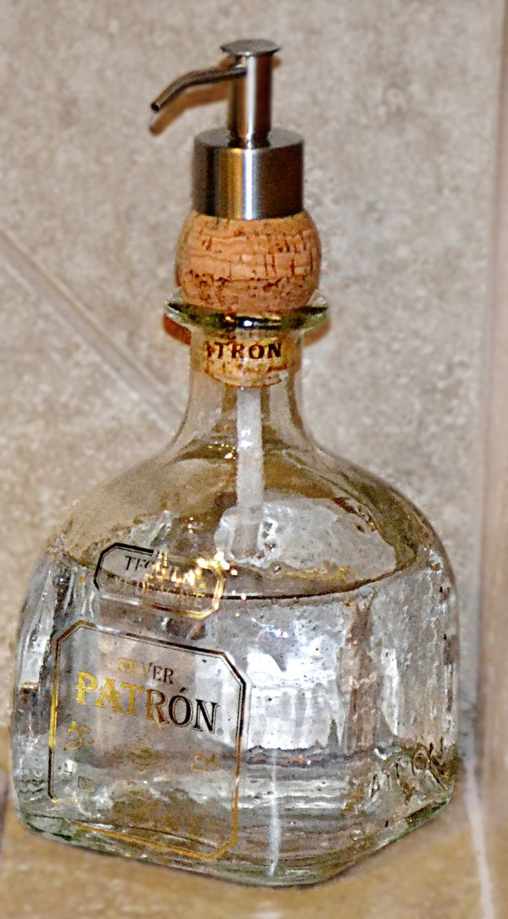 Put a dispenser through a cork into any type of bottle to make a soap dispenser. #DIY