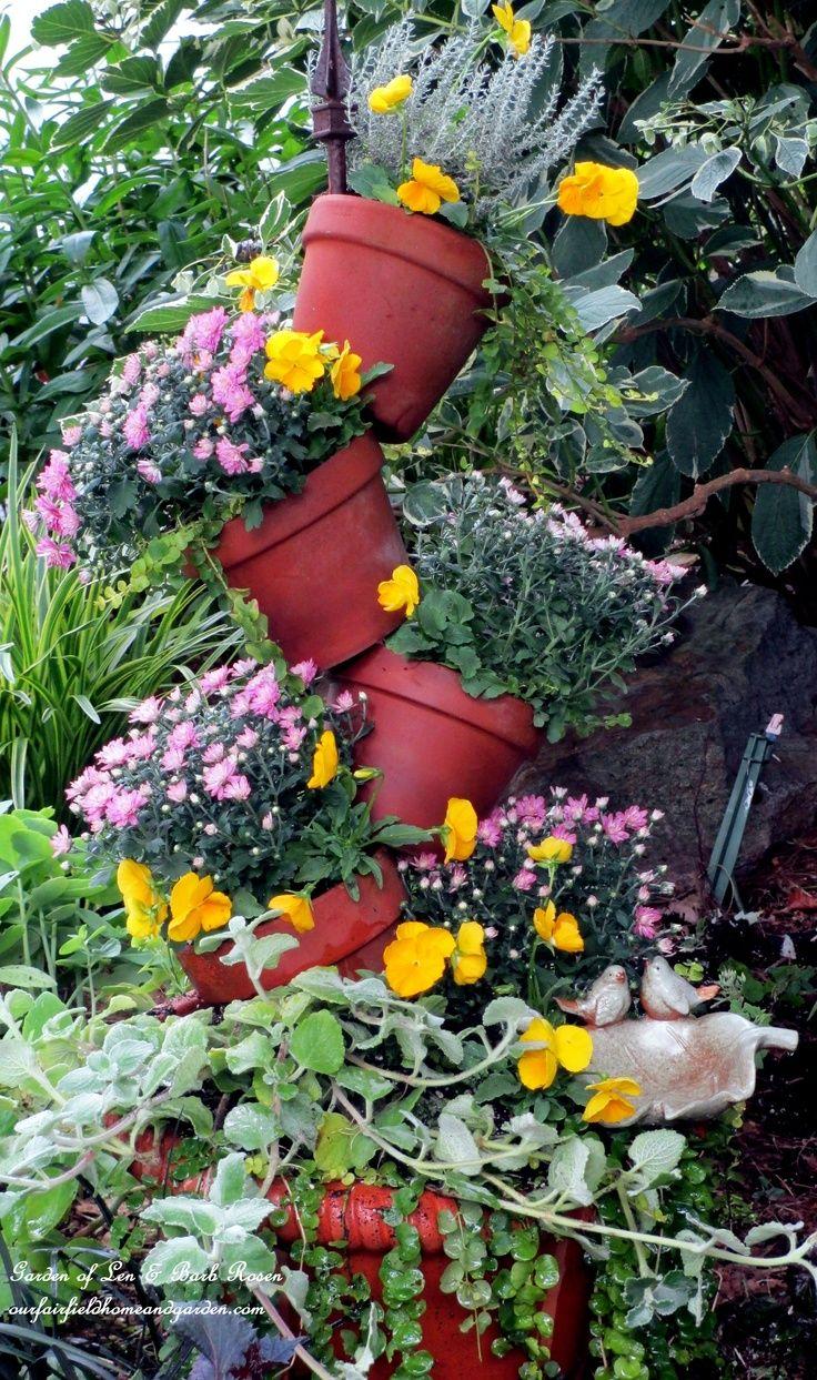 Lots of container garden ideas - cute flower pots, unusual arrangements