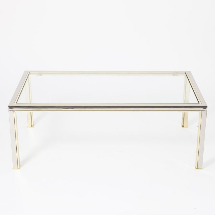 Designed by ROMEO REGA ITALY Circa 1970  Elegant coffee table by Romeo Rega made of solid chromed metal with brass insertions and a thick glass top.  SIZE Height: 43 cm Width: 118 cm Depth: 69 cm  STOCK 1 Available