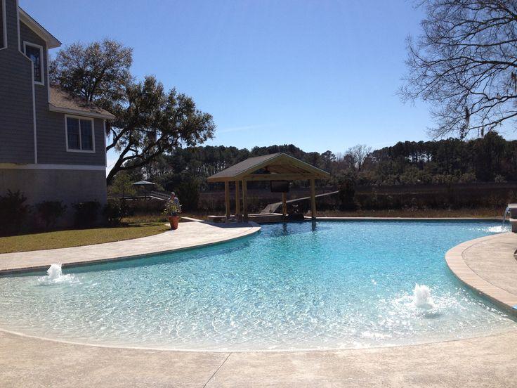 Love our new pool! Beach entry with swim up bar. Www.meadowspoolandspa.com