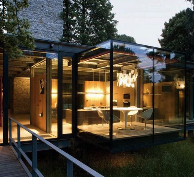 Mixed Use Glass and Natural Material Home In Poland