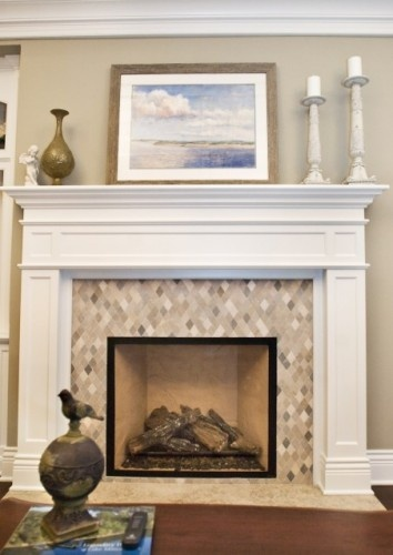 that is a very pretty fireplace love the diamond cut mosaic tile white mantle - Fireplace Surround Ideas