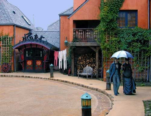 RAT'S RESTAURANT in Hamilton, New Jersey. On the left, the restaurant entrance is inspired by Mr. Toad's gypsy caravan from The Wind in the Willows. Those two fashionable folks on the right are actually painted bronzes by J. Seward Johnson, Jr.