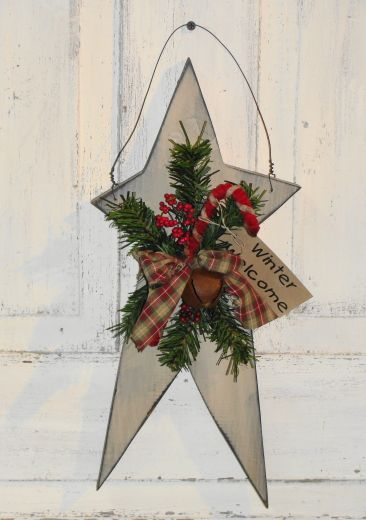 I have painted this star in linen with black underneath the topcoat. It has been distressed all over for a primitive look. It has pine and berry accents with a rusty bell and a candy cane with homespun tie. (Home spun may vary due to availability at the time of your order). Will look nice hanging alone or you can add it to a simple primitive grapevine wreath for your winter home décor. Measures approx. 8 x 17 MADE TO ORDER ITEM