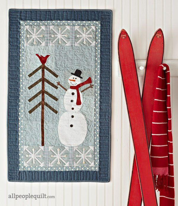 Capture the feeling of winter with a whimiscal snowman wall hanging.
