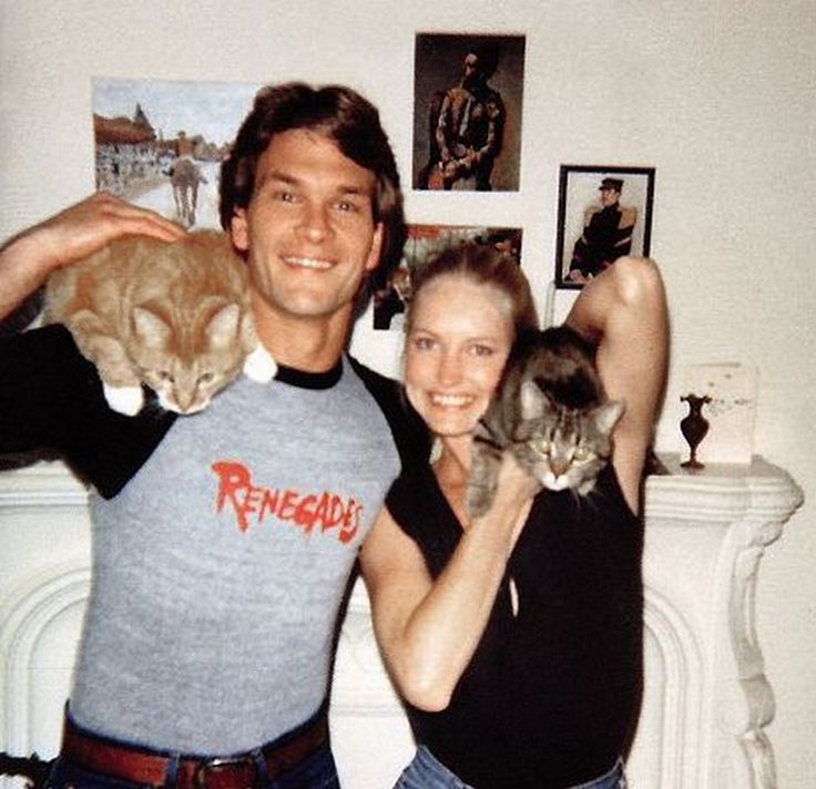 Patrick Swayze and wife with their feline fur children.