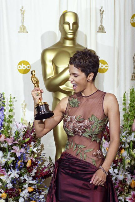 Halle Berry (in Elie Saab gown w/ crimson satin skirt & embroidered flowers & vines): Best Actress in 2002 for Monster's Ball