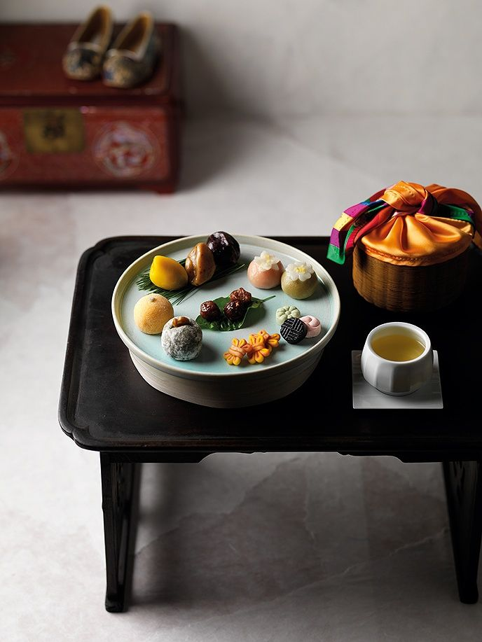 Lovely setting of rice cakes on a modern pottery and traditional table.
