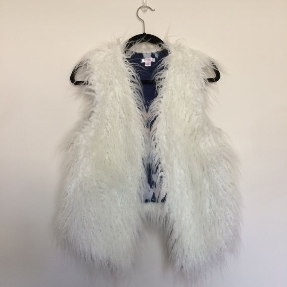 I just discovered this while shopping on Poshmark: NWOT - Fuzzy White Faux Fur Vest. Check it out!  Size: L, listed by onegirlstrash
