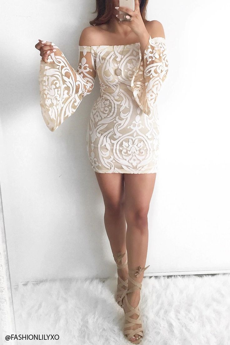A knit off-the-shoulder dress featuring a burnout baroque design, an elasticized collar, long trumpet sleeves, and a bodycon dress.