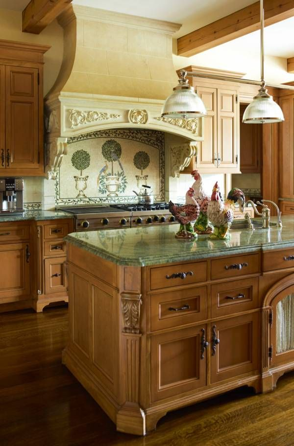 French Country kitchen elements. Chickens are a must. Lots of corbels on the island. And the range hood area tile has the Topiaries.
