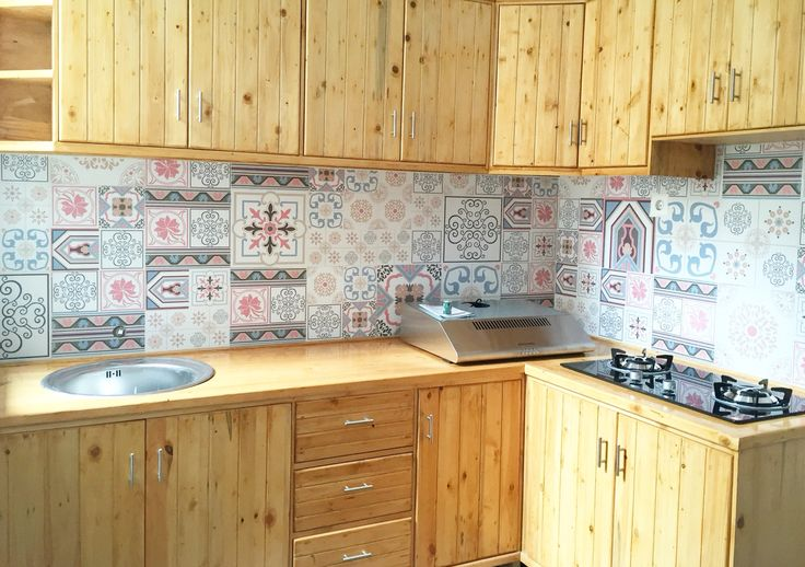 Before after renovation house with low budget. Kitchen with wood pallet and flower tiles by Putu Decor