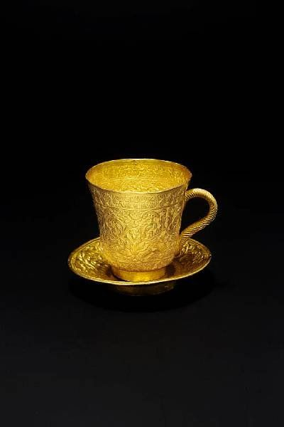 A gold coffee cup and saucer; Thailand or Burma, 19th Century