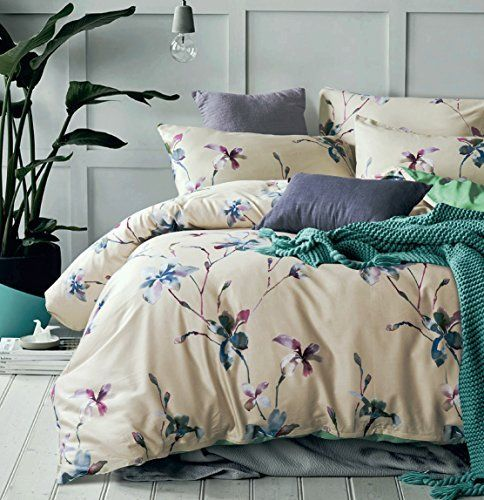 beautiful duvet set with a delicate magnolia flower branches in mauve lilac green and denim blue on a cream beige background premium quality bed l