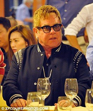 Elton John, 69, looked to be the life and soul of the party as he dined out with husband David Furnish, 53, and friends in Portofino, Italy, on Friday.