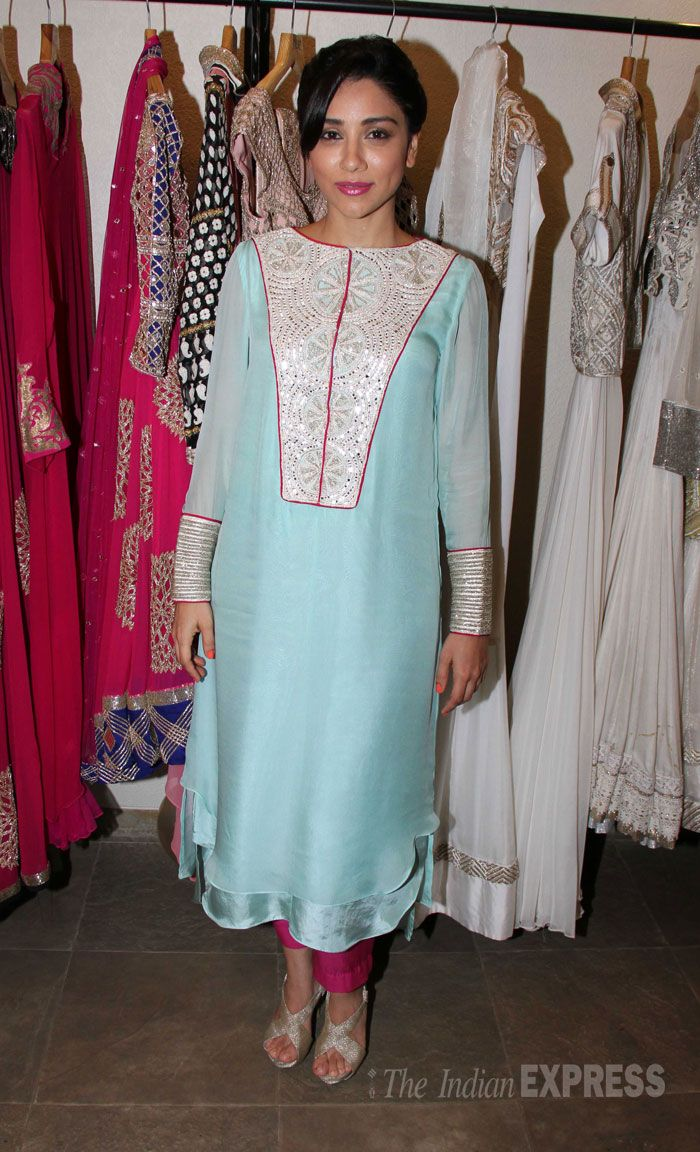 Amrita Puri looking lovely in a pale blue kurta with bright pink bottoms.
