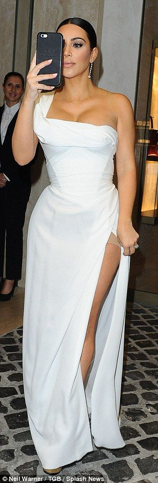 The stunning mother-of-two looked sensational as she slipped her famous curves into a very figure-hugging white number