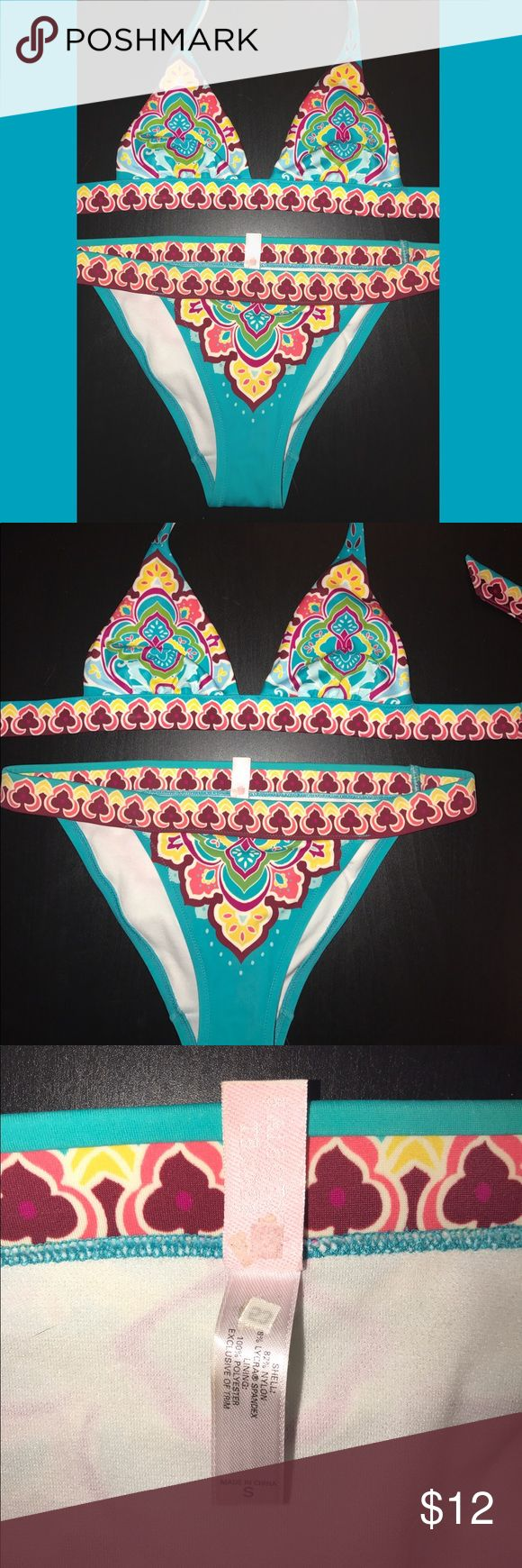 Victoria's Secret Azteca Bikini Set XS/SMALL ☀️💗 Victoria's Secret Bikini Set💗☀️ Top: XS. Bottoms: SMALL. Great condition! Beautiful tribal floral design. **Top is not padded-- this style is from a few years back** GUARANTEED FAST SHIPPING! Victoria's Secret Swim Bikinis