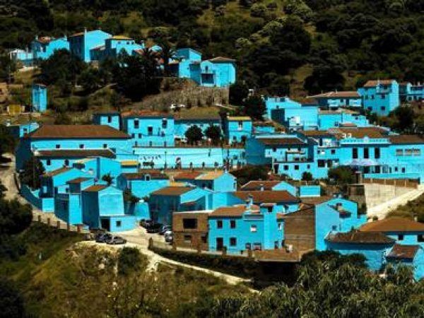 The small city of Juzcar in southern Spain was painted blue as a film location for The Smurfs movie. Sony Pictures offered to repaint all the homes but the residents voted yesterday to stay blue
