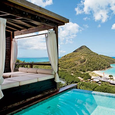 Antigua: Hermitage Bay, On Antigua's west coast, this resort feels like a Caribbean Bali Hai. Along the white-powder shore, chaise lounges and umbrellas invite relaxing days.