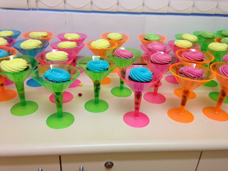 80s Party Birthday Cakes : red velvet cupcakes with neon frosting displayed in glow in the dark neon martini glasses. Absolutely Awesome! Thanks Bree!