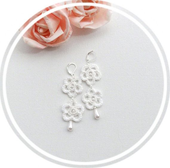 These lovely earrings are made using white Anchor Pearl cotton and finished with white pearl glass beads .    The earrings length approx 6,5 cm they have Silver plated hooks    Comes in pretty organza gift pouch.      All my pieces are made from the heart and carefully handcrafted with attention to detail from start to finish in a smoke free environment.