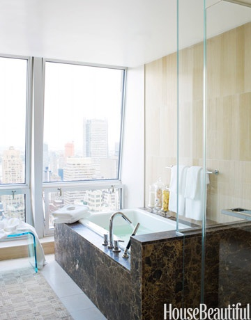 tub and window, all it is missing is a glass of wine