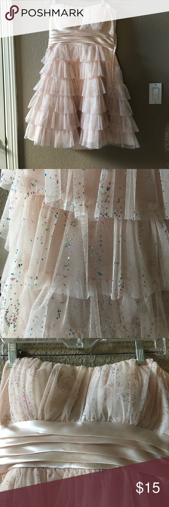 Light Pink Strapless Dress with Jewels Light pink/light peach color with mini silver, pink, blue, and green jewels all over. Zipper on the left side.  Size 13/14 Dresses Strapless