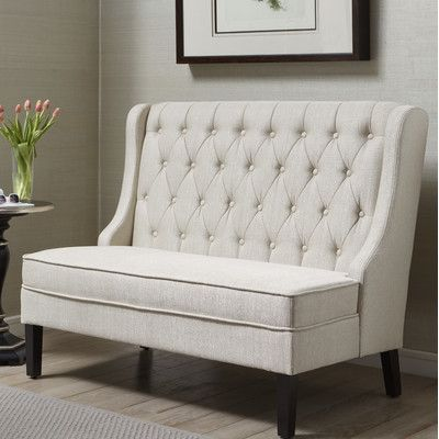 Features:  -Back is inset by shaped wings and folded seams.  -Back is angled and not straight.  -Seat is webbed and padded for comfort.  Bench Type: -Entryway bench.  Seat Material: -Fabric.  Finish:
