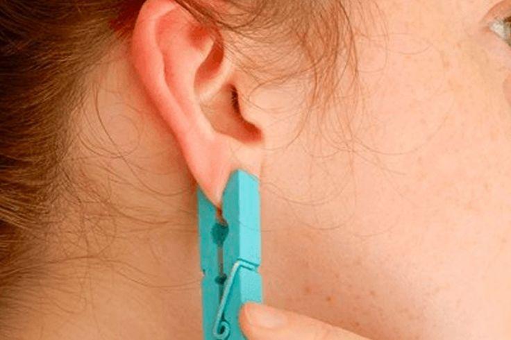 Ce qui arrive lorsqu'elle place une pince à linge sur son lobe d'oreille est vraiment dingue!