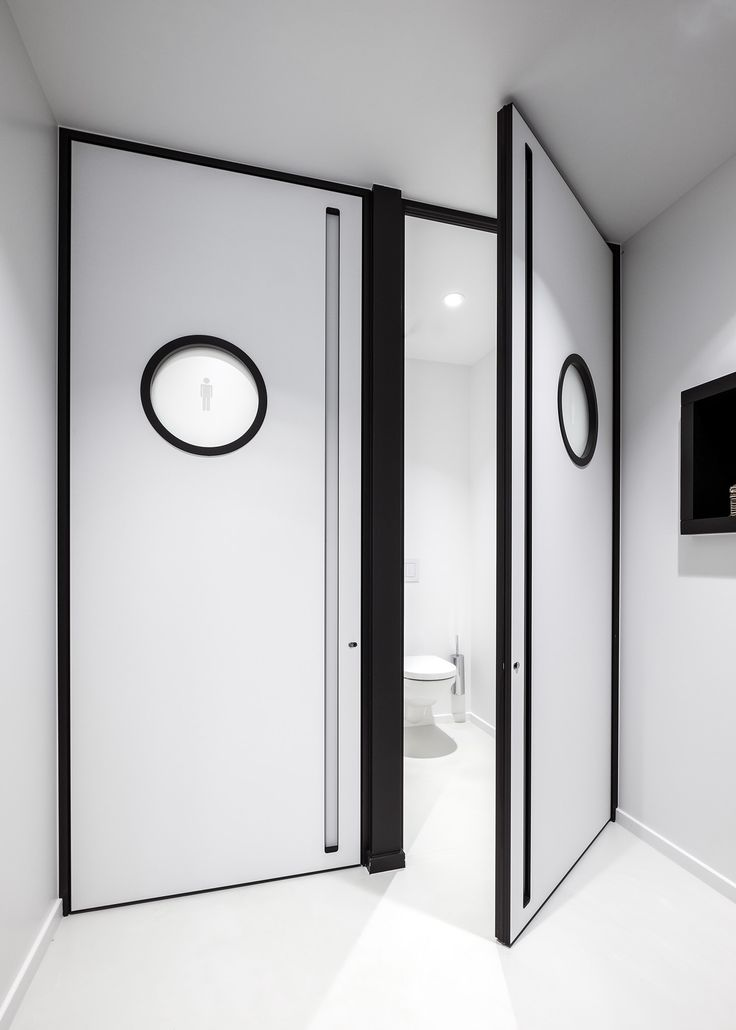 Modern White Interior Doors With Black Accents In The Door Frame, Handle  And Porthole Ring