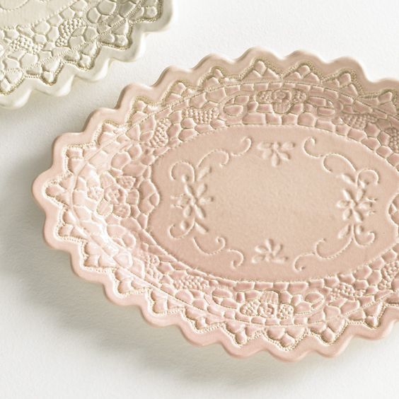 The dishes are made using craft porcelain, a clay-like material that requires no baking. (Craft porcelain is available at Hobby Lobby for $7.99.) After rolling out the craft porcelain, a piece of lace is pressed gently on top to create the design. A sharp instrument is then used to remove the excess. Placing the clay in a rounded container allows the piece to dry in the shape of the bowl. The piece will be dry in about 24 hours.: