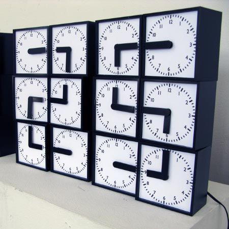 the clock clock - a digital clock made of 24 analogue clocks that spell out the time with their hands, created by Swedish designers Humans since 1982