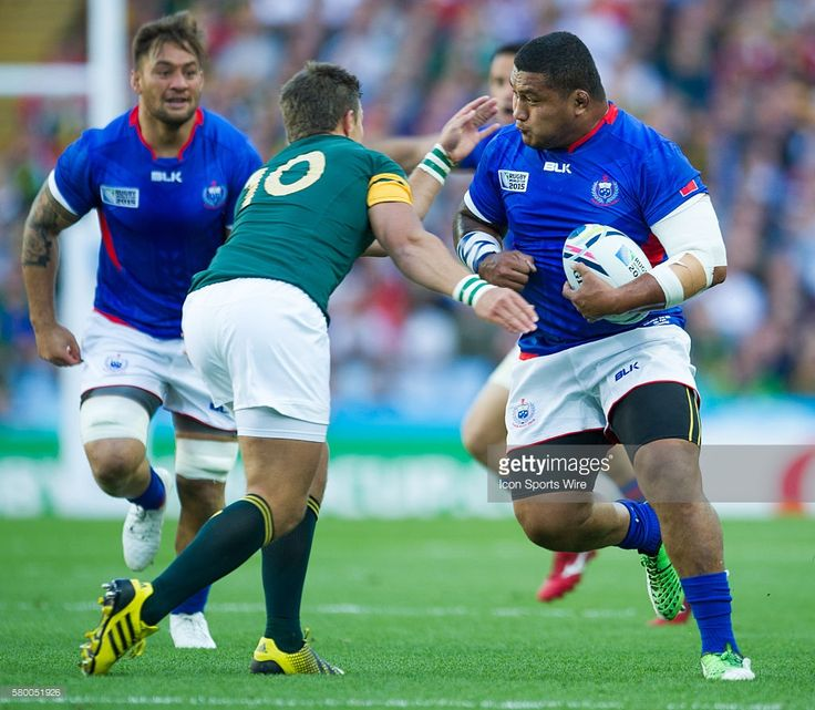 Samoa's Zak Taulafo brushes off the tackle of South Africa's Handre Pollard during the 2015 Rugby World cup match-up between South Africa and Samoa being held at Villa Park in Birmingham, United Kingdom. South Africa would win 46-6.