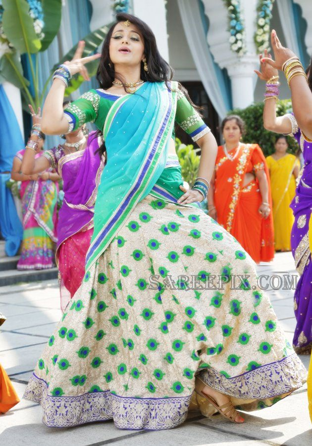 South indian actress Trisha cute dance stills in half saree. She looks beautiful in multi color and printed lehenga half sarees.