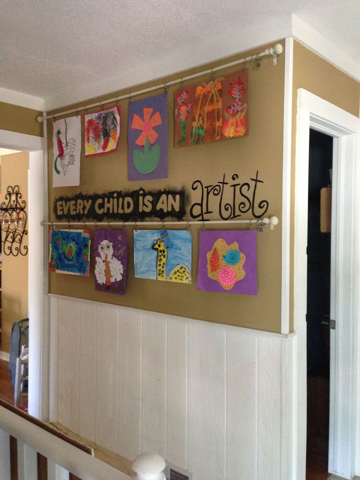 Child art work display- curtain rods and clips.