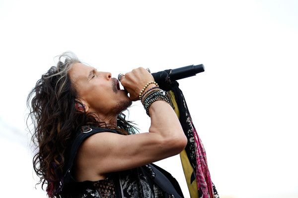 Steven Tyler Photos - Steven Tyler performs prior to the NASCAR Sprint Cup Series IRWIN Tools Night Race at Bristol Motor Speedway on August 22, 2015 in Bristol, Tennessee. -