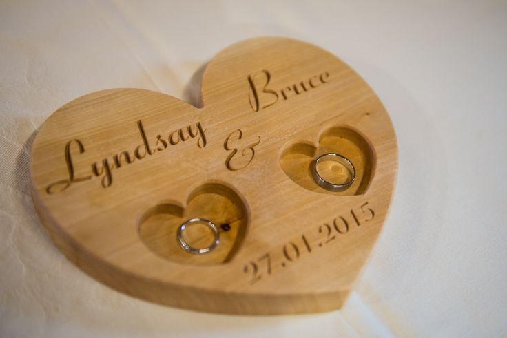 A personalized wooden wedding ring holder, a ring bearer pillow. Made by Klik Klak Blocks www.etsy.com/shop/KlikKlakBlocks