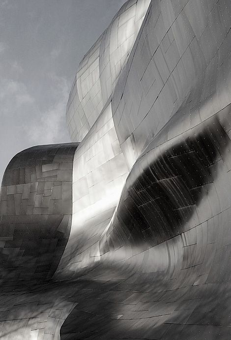 Luminous & sensual undulating metal surface by architect Frank Gehry.  Is it architecture or is it sculpture?