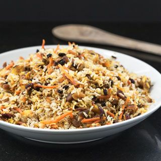 Recipe for Persian Jeweled Rice, with brown basmati rice, pistachios, almonds, saffron, cardamom, carrots, and dried fruits. Part of The Kids Cook Monday series.
