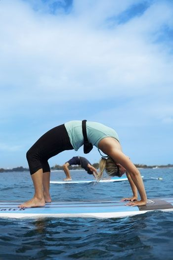 Stand-up paddle board yoga, San Diego. I will be doing this...