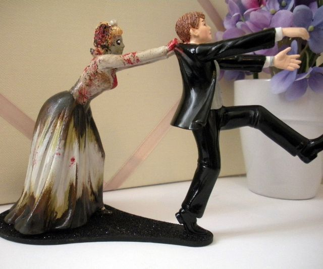 Every groom-to-be gets cold feet at some point, and this zombie wedding cake topper brilliantly summarizes both the worst and best case scenarios that could play out when that happens. Worst Case Scenario: Your feet are so cold that you actually take