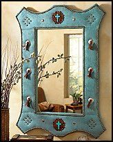 Lone Star Western Decor Exclusive - Featuring turquoise ultra suede accented with leather, two ornate turquoise jeweled crosses, metal conchos, and nail head trim, the handmade Turquoise Suede Mirror with Jeweled Crosses will be the centerpiece of any room.