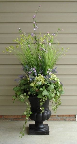 Urn with plants at a front door. Very Welcoming!!