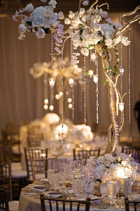 Guest tables decorated with six-foot-tall gilt-wrapped trees embellished with romantic florals - Deer Pearl Flowers / http://www.deerpearlflowers.com/reception-decor/guest-tables-decorated-with-six-foot-tall-gilt-wrapped-trees-embellished-with-romantic-florals/
