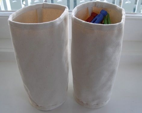 storage cylinders (they hold a surprisingly large number of items, and take up a very small amount of space on a shelf)