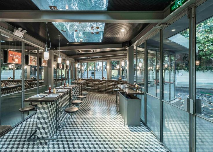 a retro inspired burger joint in shanghai has exposed metal structure a large skylight