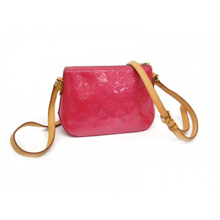 This LOUIS VUITTON Pochette NM Shoulder back in made from Monogram Vernis Patent Leather. The interior opens to an indian rose textile. The bag features a vachetta cowhide leather shoulder strap with brass links and a top zipper. This chic pochette comfortably carries your every day or night essentials and is a chic option for a lady who likes to travel light.  Find more items like this at https://www.swayy.com.au/