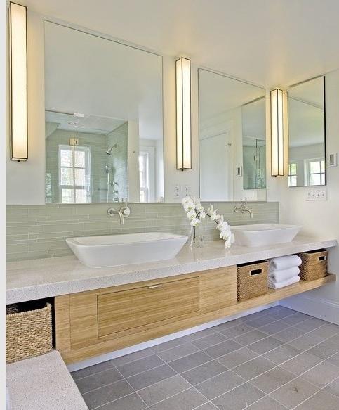 Wall-mount plumbing fixtures, side-mount medicine cabinet, rectangular floor tile, via Flickr