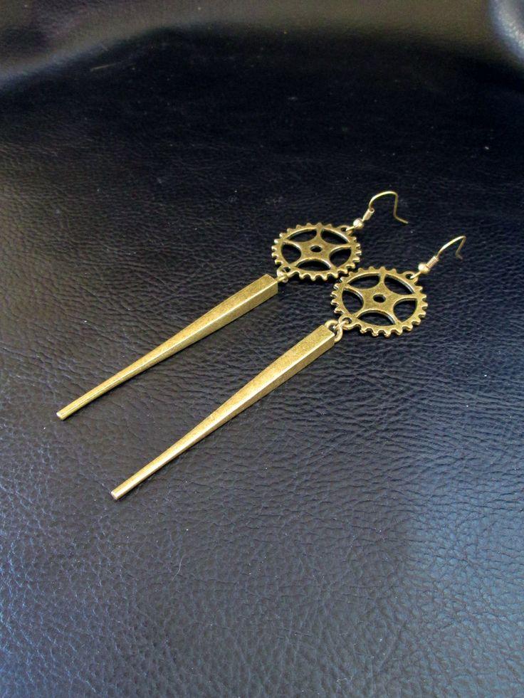 Industrial spike earrings, antique brass tone cogwheel gear and spike shoulder dusters, long modern statement earrings by LogicFreeDesign on Etsy https://www.etsy.com/listing/194656900/industrial-spike-earrings-antique-brass
